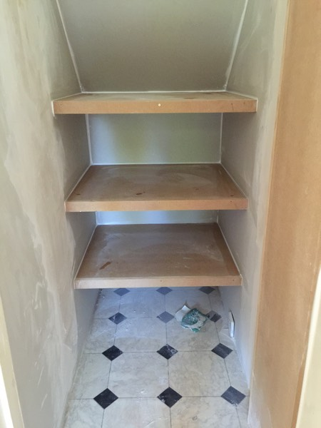 Under Stairs cupboard plastering and shelves